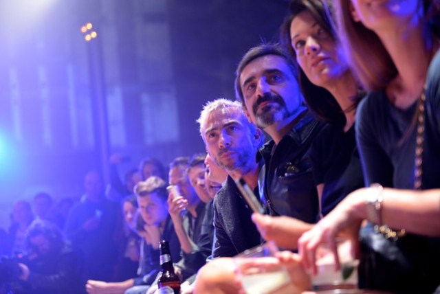 James Holder and Julian Dunkerton watch the Catwalk Show at the Superdry 10 Year Party