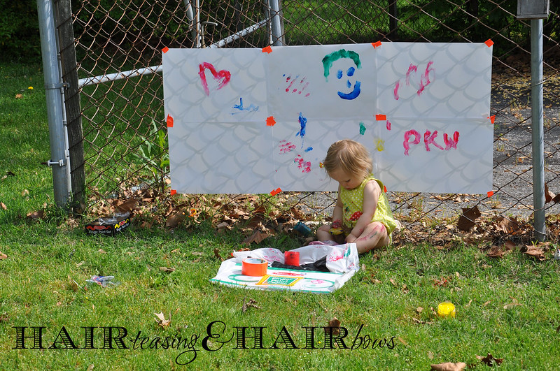finger painting on the fence