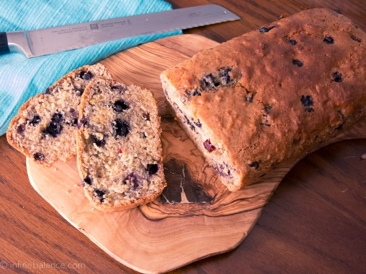 blueberry citrus loaf sliced on a cutting board