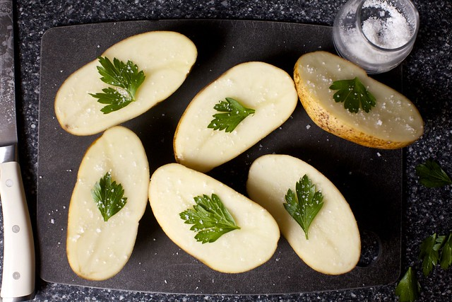 one leaf per potato half, plus salt