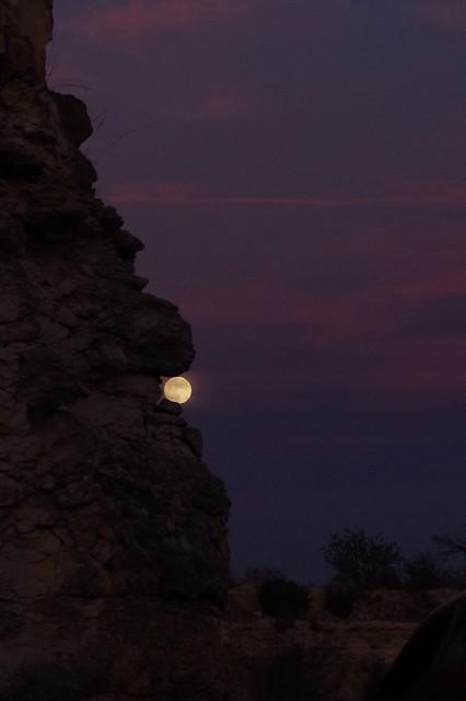 Moon caught in the Rocks