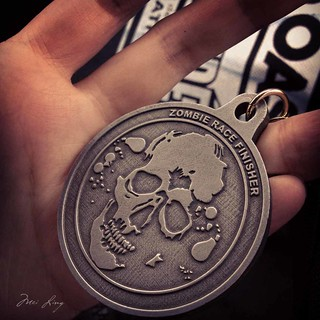 close up of the zombie race medal
