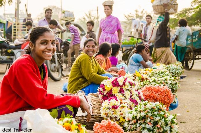 smiling girls selling flowers gudimalkapur