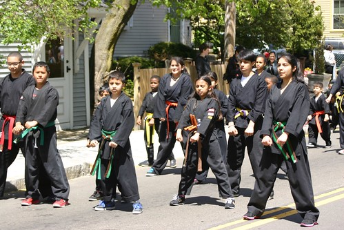 Young martial artists demonstrate their form