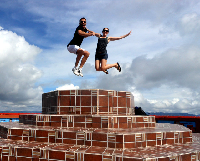 Jumping at the top of La Piedra in Guatape, Colombia.