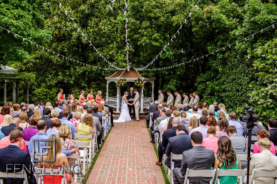 Bride and groom pray during wedding ceremony