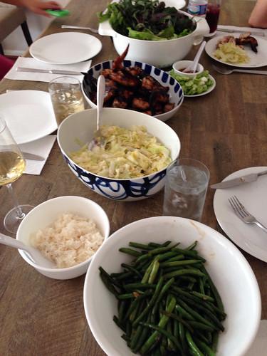 Stir fried green beans, rice, stir fried cabbage, grilled lemongrass chicken and greens.