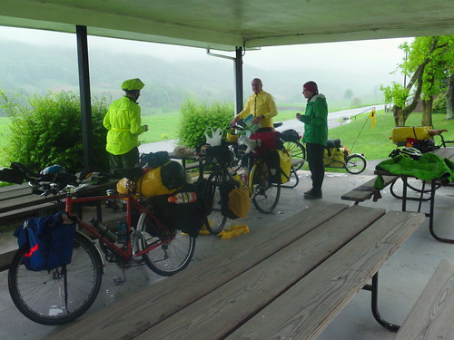 Catawba VA pavilion with cyclists on a rainy day