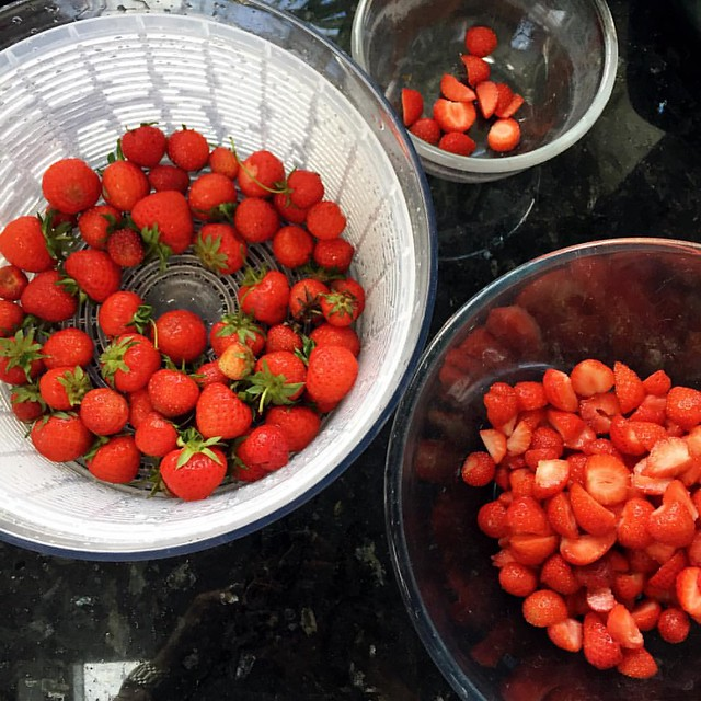 Finally dealing with the strawberry glut. Jam and some put aside for shortcakes for pudding.