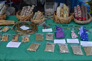 Palo Santo sticks pictured on far left at front of table