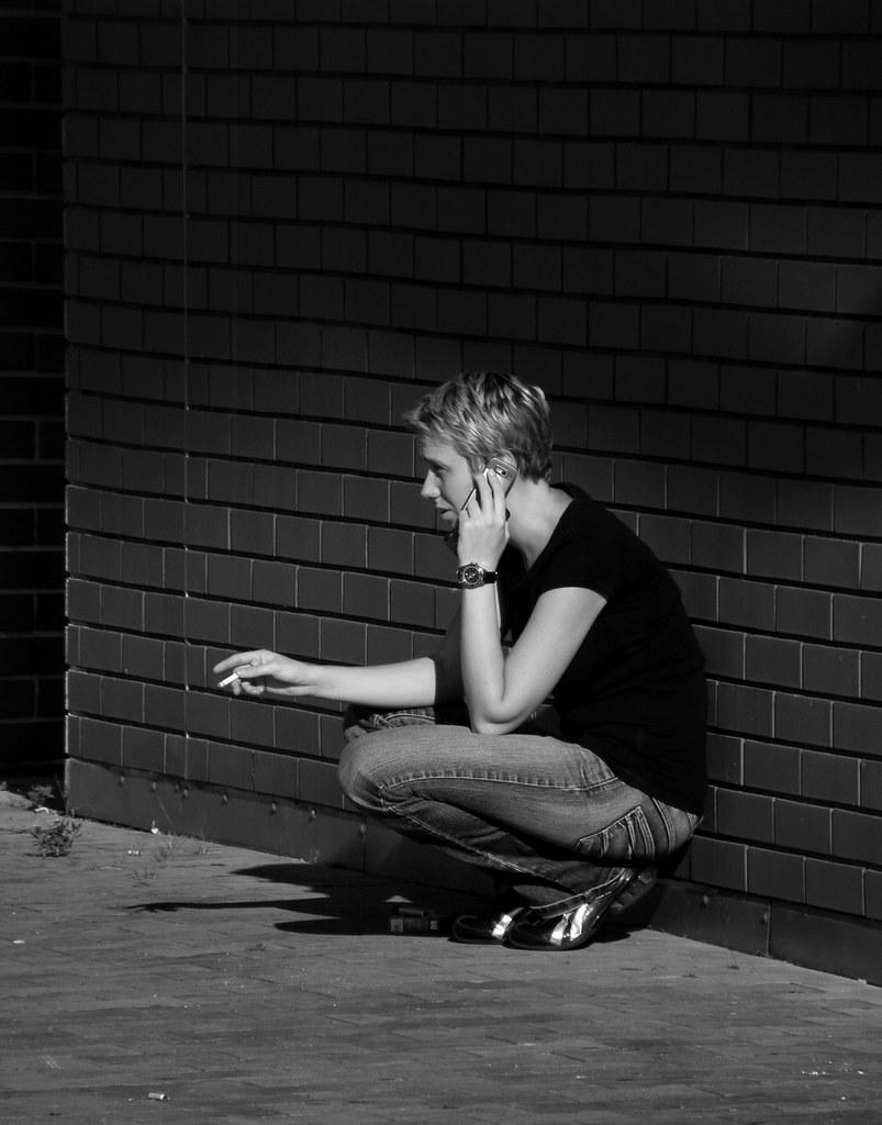 Smoking Woman Making a Phone Call