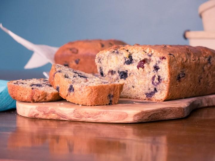 sliced vegan blueberry loaf on cutting board