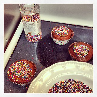 Cupcakes for a coworker's baby shower. I didn't expect the sprinkles to bounce when I poured them into the bowl...