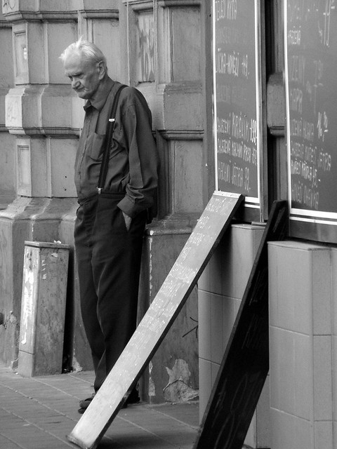 Man Hanging Around In Front Of Butcher Shop