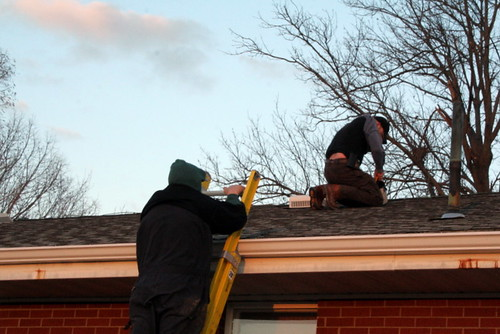 Dad and Eric Fixing Roof