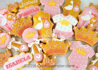 Pink and gold royal baby shower cookies