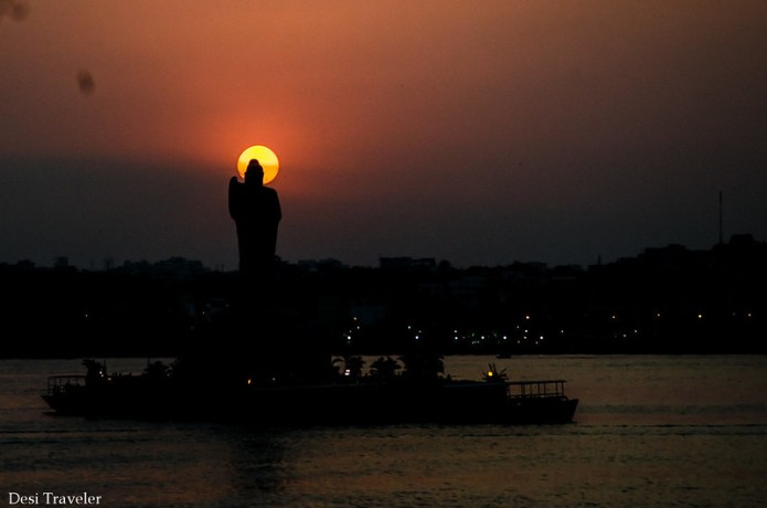 The Sun Forming an Aura Hussain Sagar 18 meters tall Buddha Statue