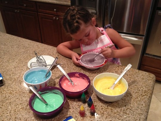 making the colors for the rainbow cake