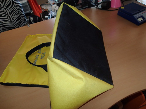 milkcrate bag is yellow with a black bottom and matching black handles