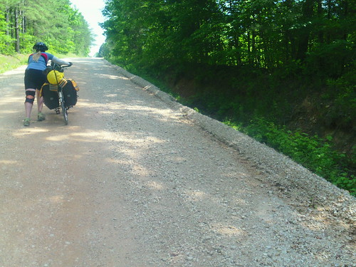 hannah pushing bike up hill in TN gravel