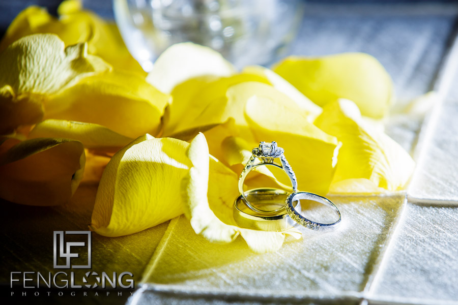Artistic photo of the wedding rings with yellow flowers