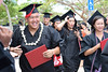 """UH West Oahu spring 2016 graduates walk to greet family and friends on the Great Lawn following the commencement ceremony on May 7, 2016. Photo by Brian Miyamoto  More photos:  <a href=""""https://www.flickr.com/photos/uhwestoahu/albums/72157665878073153"""">www.flickr.com/photos/uhwestoahu/albums/72157665878073153</a>"""