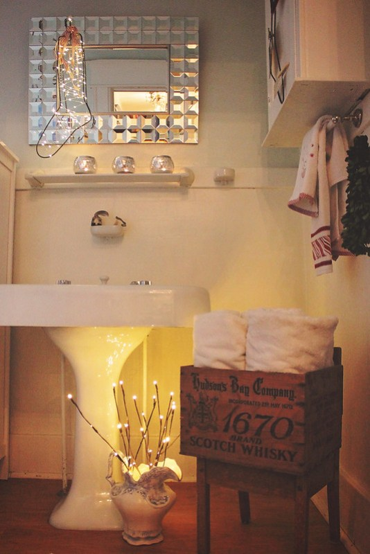 DIY Christmas Decor in the Bathroom, using vintage sock stretchers as stockings! | Alex Inspired