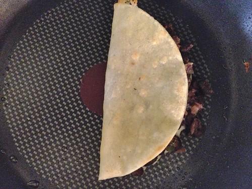 crunchy black bean taco in the pan