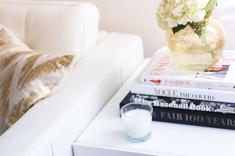 side table with coffee table books and flowers