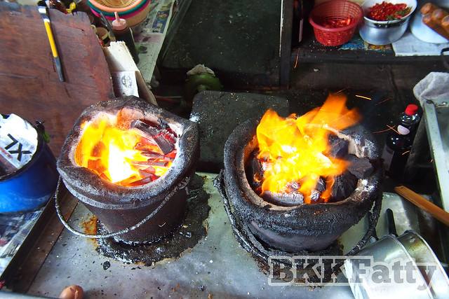 traditional charcoal cooking on the street in bangkok