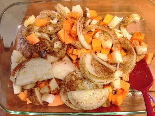 seasoning the veggies for roasted potatoes and butternut squash