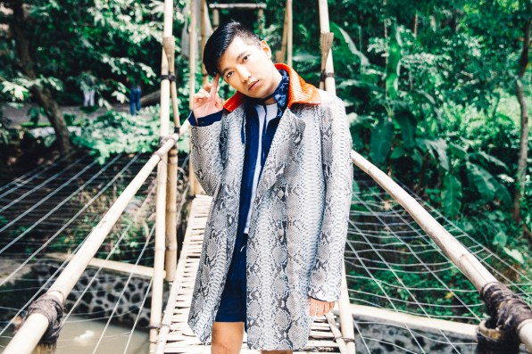 Fashion blogger Bryanboy wears a custom made python coat from Bali, Indonesia
