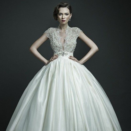Cap sleeve wedding gown with beaded Lace bodice
