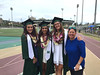 Women's soccer head coach Michele Nagamine and her three graduates, from left, Lidia Battaglia, Amanda Bates and Erica Young at the University of Hawaii at Manoa spring commencement ceremony on May 14, 2016.