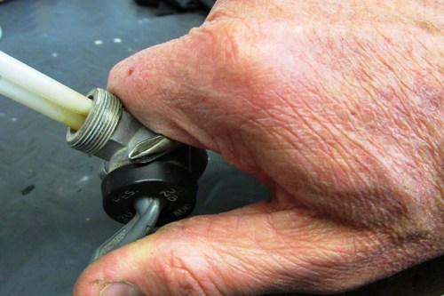 Using Philips Head Screw Driver to Remove Plastic Cap