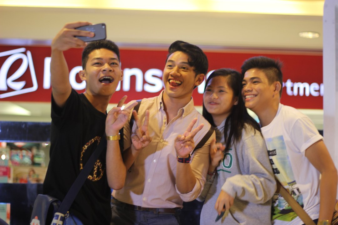 David Guison poses with Davao fans