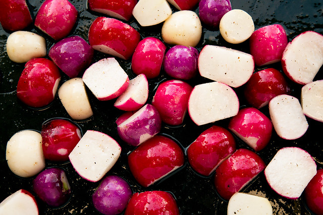 cut radishes on roasting pan