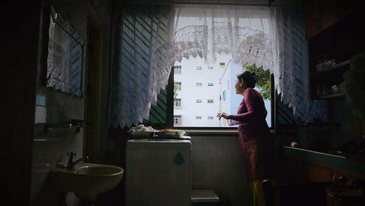Looking out the window of her Eunos flat. Credit: Singapore Chinese Film Festival