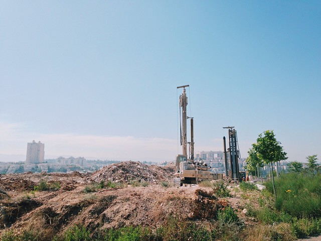 Drilling holes with the city in the background