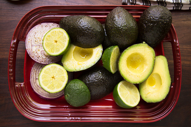 avocados, limes, and onion slices on platter