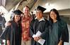 University of Hawaii students athletes, from left, Tasha Miyataki, UH Hilo Athletics Director Patrick Guillen, Ric Yamamoto and Kristen Sawada.