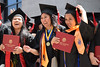 """UH West Oahu graduates celebrate after moving tassels from right to left, signifying degree conferral at the spring 2016 commencement. Photo by Brian Miyamoto  More photos:  <a href=""""https://www.flickr.com/photos/uhwestoahu/albums/72157665878073153"""">www.flickr.com/photos/uhwestoahu/albums/72157665878073153</a>"""
