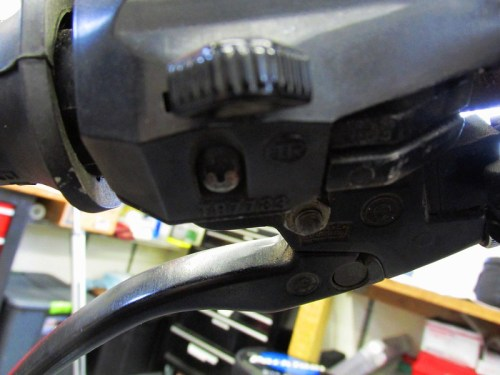 Left Handlebar Combination Switch Secured at Bottom With Phillips Head Screw