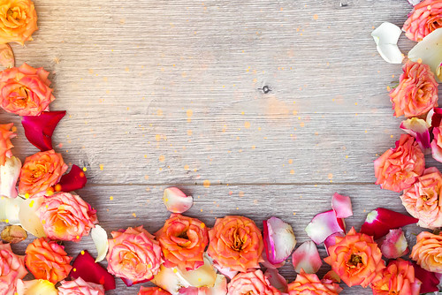 Flowers composition on wooden background. Valentines day background. Flat lay, top view, copy space.