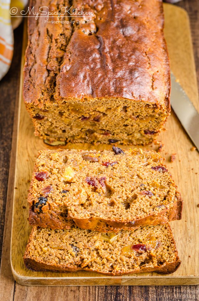 Sliced loaf of classic non alcoholic healthy fruit cake