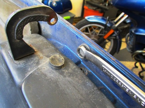 Removing Seat Rail Front 10 mm Bolt From Inside Cowl