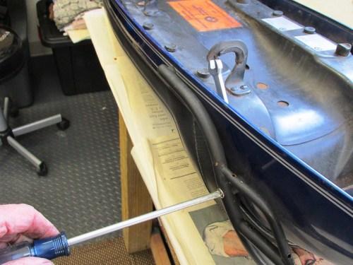 Removing Seat Rail Rear Phillips Head Screw