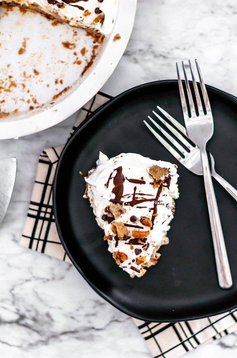 Chocolate Chip Cookie Dough Ice Cream Pie is the ultimate dessert. Cookie dough crust, cookie dough ice cream, whipped cream and chocolate syrup.