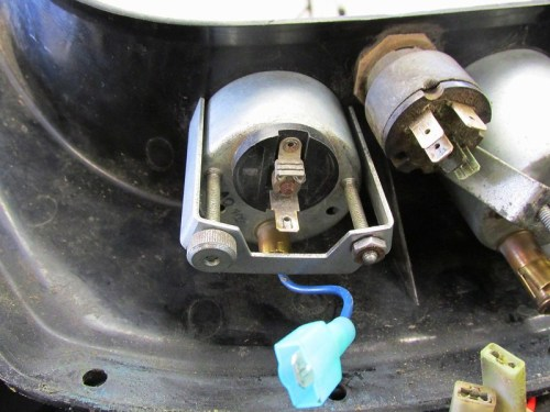 Removing Volt Meter Bracket by Removing Two Knurled Nuts