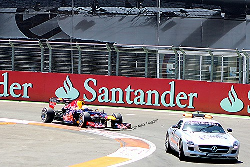 Sebastian Vettel follows the safety car in his Red Bull Racing F1 car during the 2012 European Grand Prix in Valencia